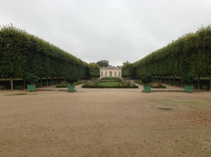 view of the petit trianon from the end of the gardens
